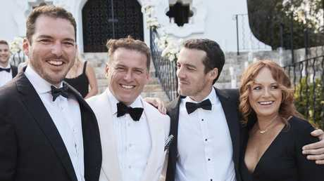 Stefanovic with two of his groomsmen, brothers Pete and Tom, and his sister Elisa.