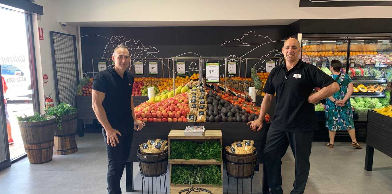 NOW OPEN: IGA Kingsthorpe fruiterer Brendan Cullen (left) and owner Tony Wilkes celebrate the opening of the supermarket this week.