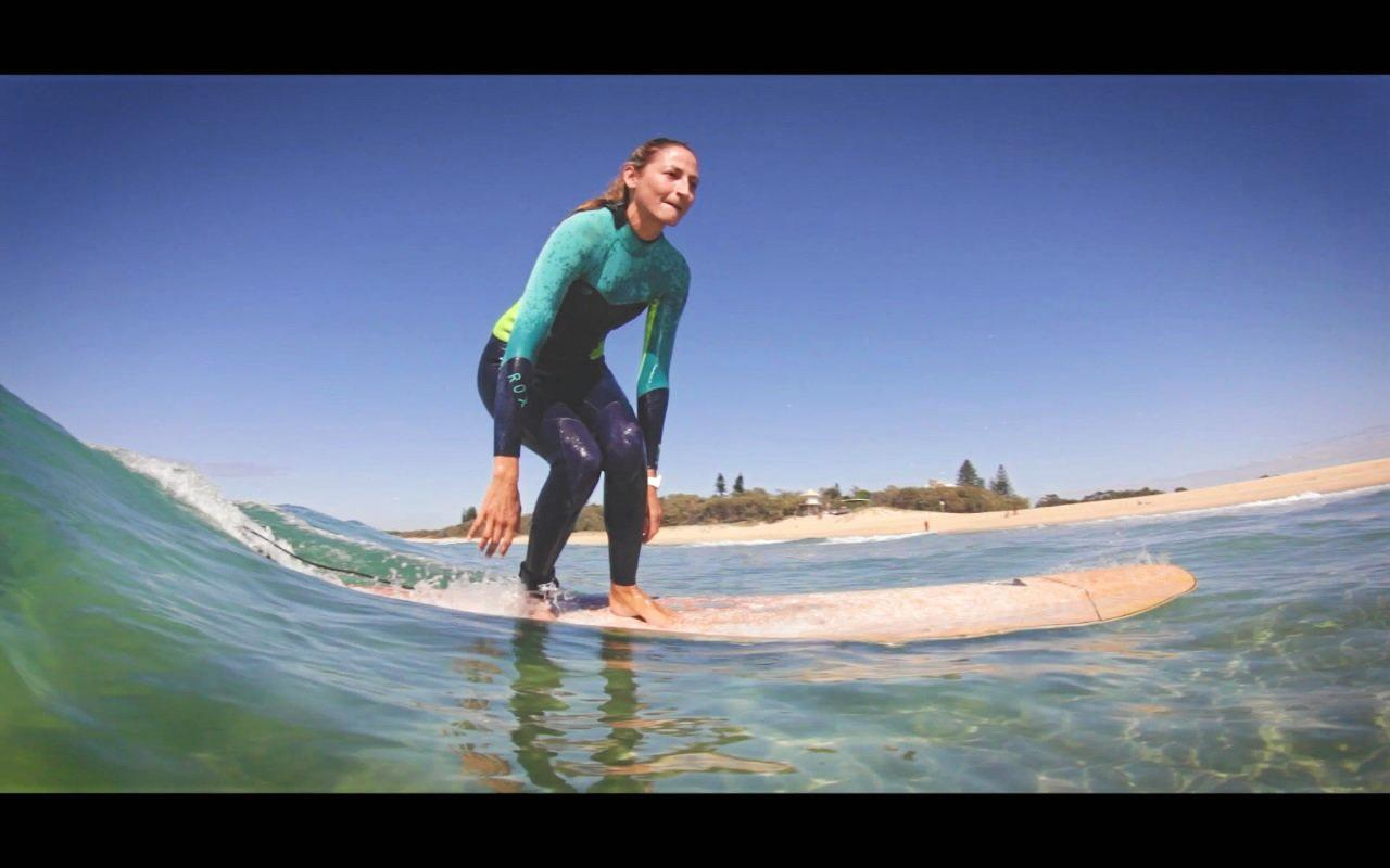 GO GURFER: Caloundra Surfing Mums coordinator Erika Kirk getting salty in the surf.