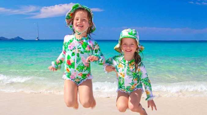 JOIN THE TRIBE: Bargara mum Emily Gradon saw the need to protect her daughters, Anelise and Lilia, from the sun, she's created these swimsuits as part of her new business Tribe Tropical.
