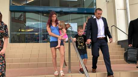 Stephanie Lee Mackay and partner Jamie John Blake with their children Alli, 2, and Callum, 6, leaving Rockhampton courthouse after the couple were sentenced for giving Callum marijuana oil illegally for his severe autism.