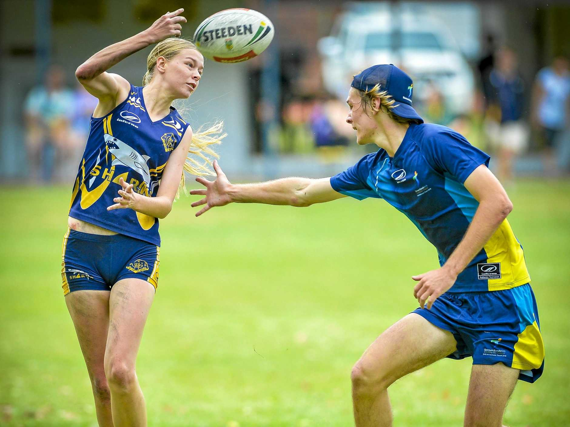 SLIPPERY SHARK: Georgie Hare from State High Sharks avoids a touch from Ferguson Comrie in the Gladstone Touch Association Mixed Division 2 grand final against Tannum Sands SHS.