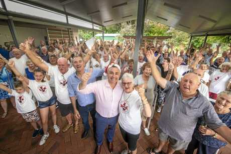 The Iluka community who gathered at the Iluka Bowling Club celebrate the announcement with deputy premier John Barilaro they will get an ambulance station.