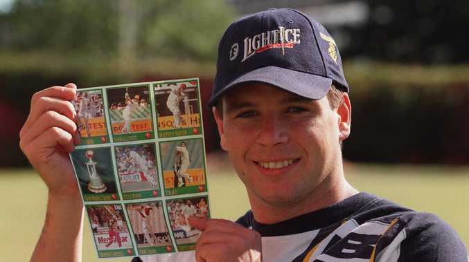 061196.Victorian cricketer Brad Hodge helping to promote the Herald Sun cricket stickers .p/