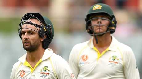 Nathan Lyon and Josh Hazlewood walk off the Adelaide Oval after the loss. Picture: Getty