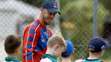 Chris Lynn with young fans at a club game. Picture AAP David Clark