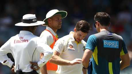 Tim Paine receives some attention on his finger. Picture: Getty