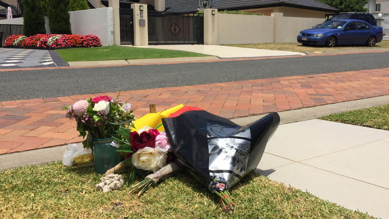 Floral tributes left opposite the home of a Sovereign Islands family, at the spot their one-year-old boy lost his life on Friday (7/12/18).