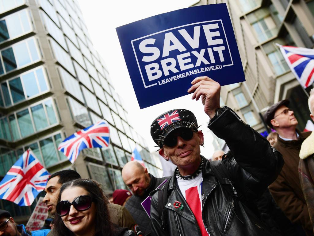 People take part in a pro-Brexit rally. Picture: Getty