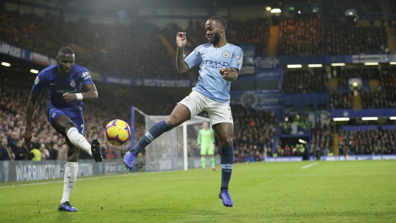 Chelsea's Antonio Rudiger and Manchester City's Raheem Sterling compete for the ball. (AP Photo/Tim Ireland)