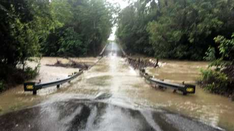 The inundated Dalrymple Bridge this morning. Floodwaters were 300mm over the bridge, cutting Hawkins Creek Road near the Bruce Highway just north of Ingham. Picture: SUPPLIED