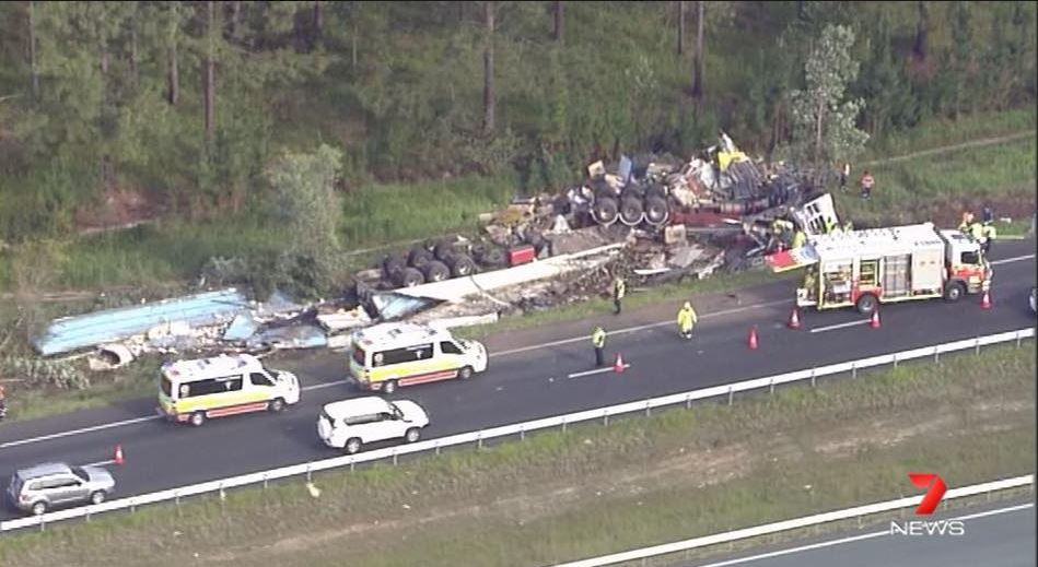 A man is trapped in a truck after a truck smash on the Bruce Highway at Beerburrum this afternoon. Image via 7 News Sunshine Coast.