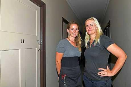 Emma and Sally outside Room 11 of Joe's Grand Hotel in Goomeri.
