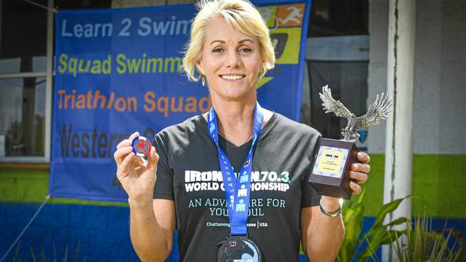 GOLDEN GIRL: Leonie Anderson proudly displays her trophy that she won after she finished first in the Ironman 70.3 in Malaysia. She now qualifies for the World Championships in France in 2019.
