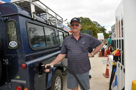 Mapleton resident Russell Callow fills up his four-wheel-drive and his jerry cans when he sees a good fuel price.