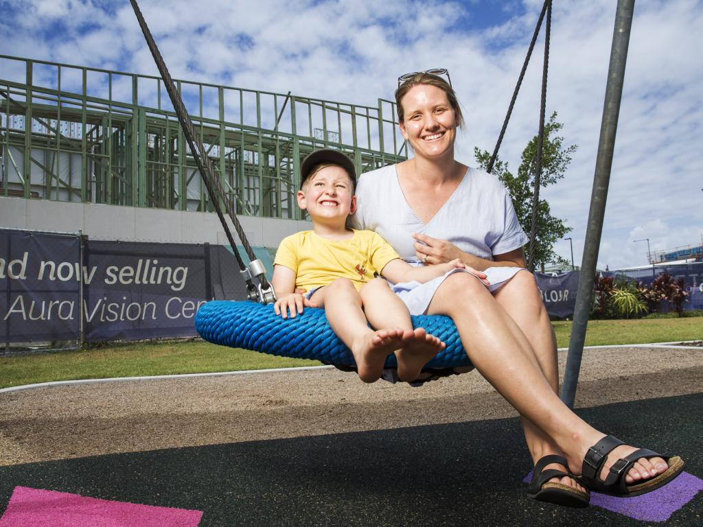 Anne Morse with son Arthur, 5, who moved into their new family house in Aura a week ago. Anne says everything that has been promised at Aura has been delivered. Picture: Lachie Millard