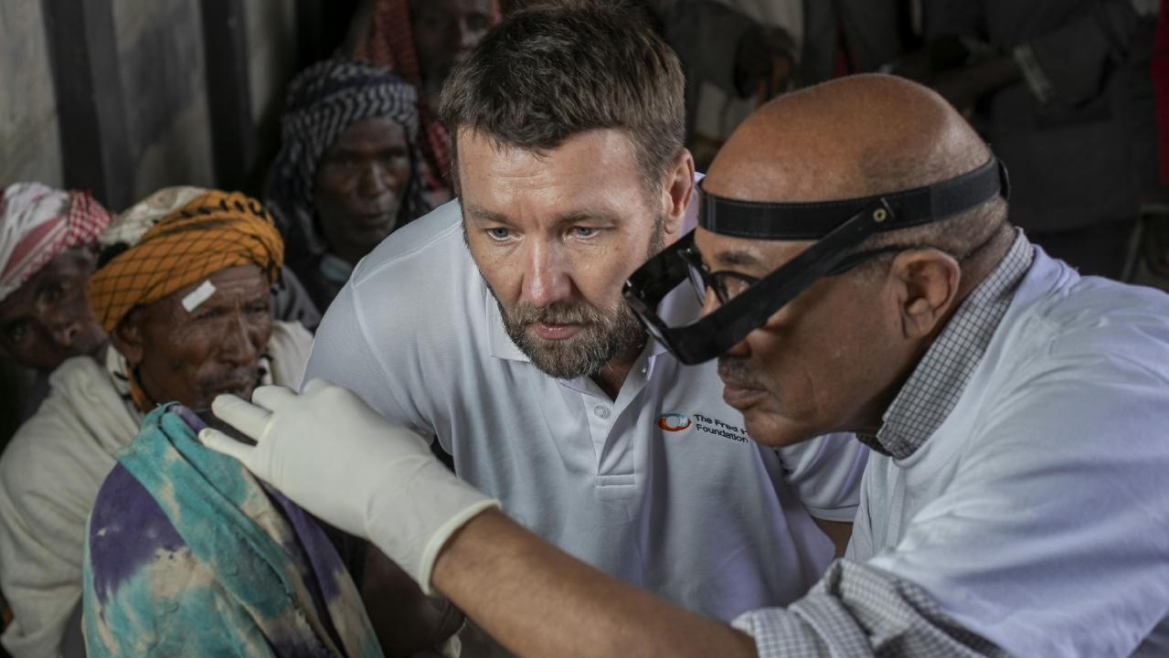 Dr Wondu Alemayehu, technical adviser to The Fred Hollows Foundation on trachoma, showing Joel the problem and the work. Picture: Michael Amendolia/Fred Hollows Foundation