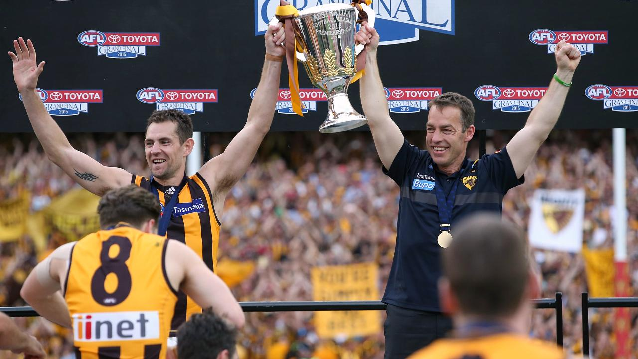 Alastair Clarkson holds the 2015 premiership cup aloft with former captain Luke Hodge. Picture: Wayne Ludbey