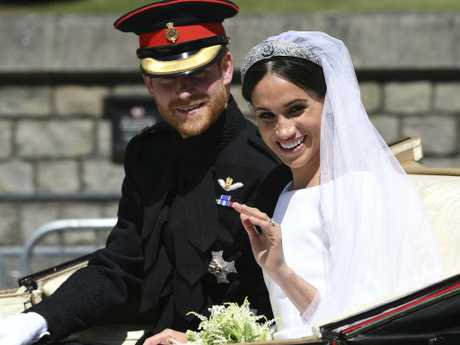 FILE - In this May 19, 2018, file photo, Britain's Prince Harry, Duke of Sussex and his wife Meghan Markle, Duchess of Sussex wave from the Ascot Landau Carriage during their carriage procession on Castle Hill outside Windsor Castle in Windsor, England after their wedding ceremony.