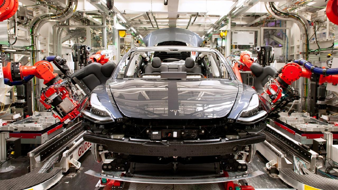 Robots on the Model 3 assembly line at the Tesla factory in Fremont, California. Picture: Brian Molyneaux
