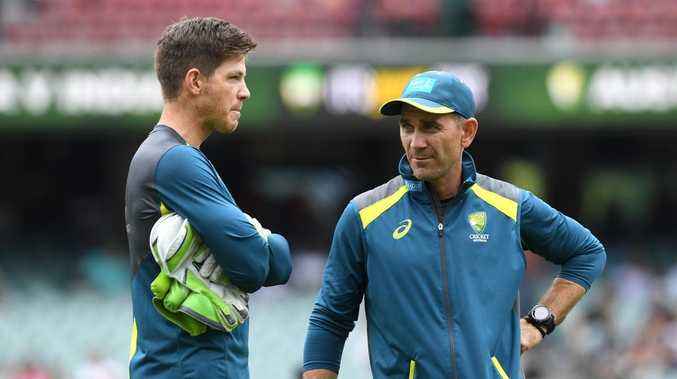 Tim Paine with coach Justin Langer. (AAP Image/Dave Hunt)