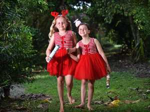 Abigail,9,and Ebony,7, Quirke ready for gift giving