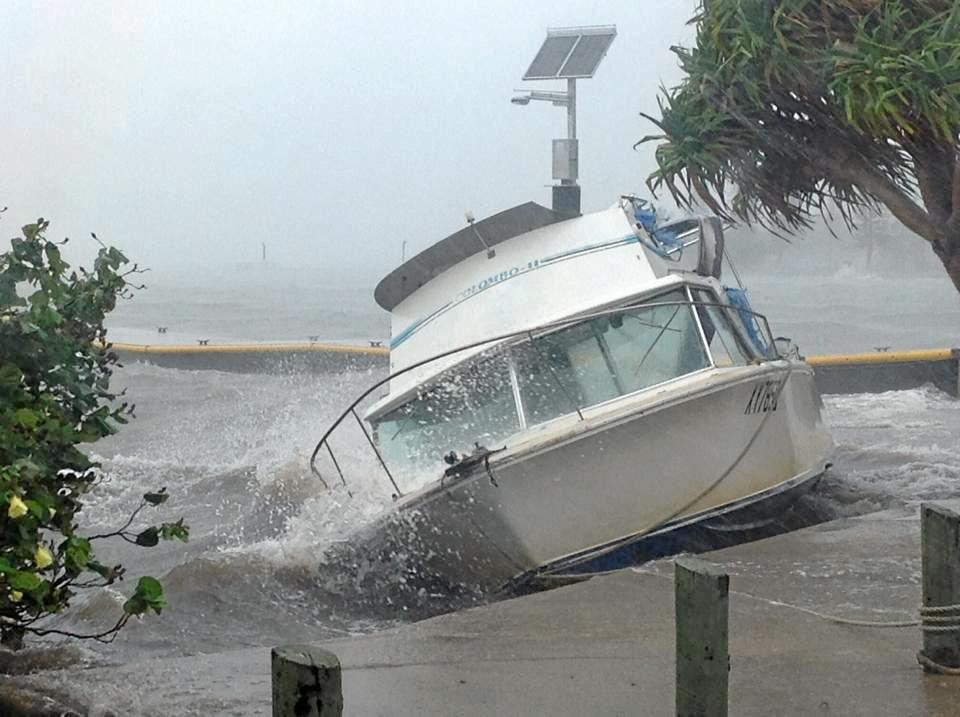 The Bureau of Meteorology was forecasting a once-in-a-decade powerful weather event to explode over the Sunshine Coast this weekend potentially more damaging than the remnants of Cyclone Oswald which battered the region in 2013. In 2013 this boat was smashed against the boat ramp next to Caloundra Power Boat Club, Golden Beach. Photo: Barb Blewitt