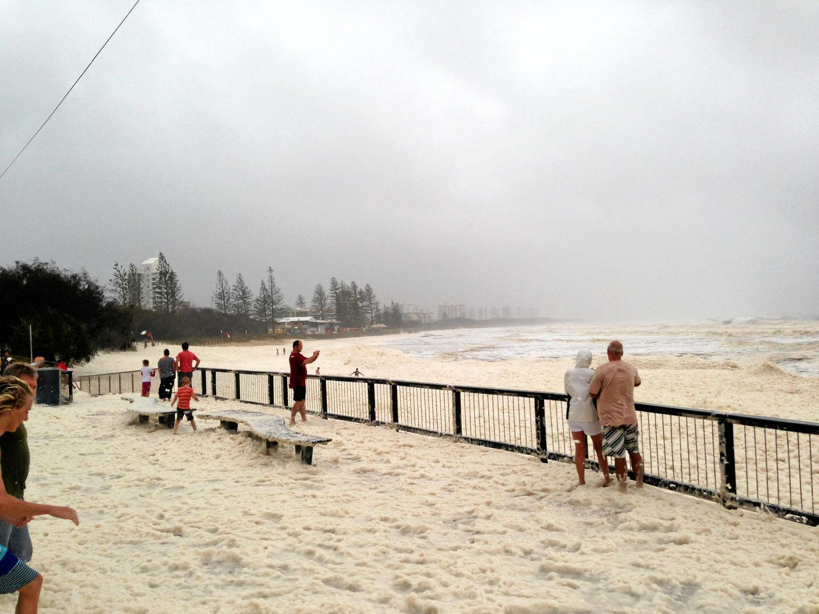 In 2013 ex-cyclone Oswald created damaging surf conditions and drove foam up onto the roadway at Alexandra Headland. The Bureau of Meteorology has forecast winds to 130 kmh this weekend from Tropical Cyclone Owen. Photo: Bridget Chenoweth
