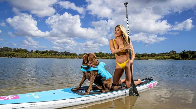 Liv Hall and her dog Kona at Currumbin Creek.