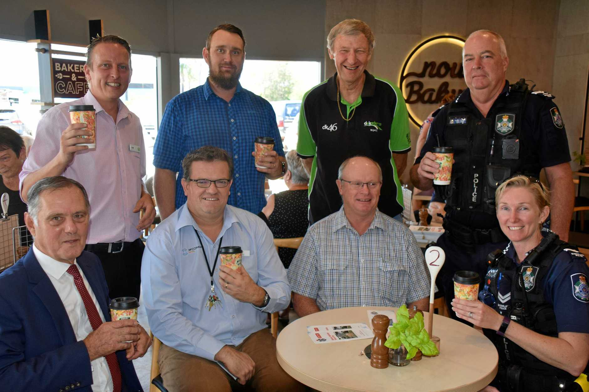 CHEERS: Current Kingaroy police are joined by retired officers and Kingaroy Shoppingworld staff for the Coffee with a Cop event.