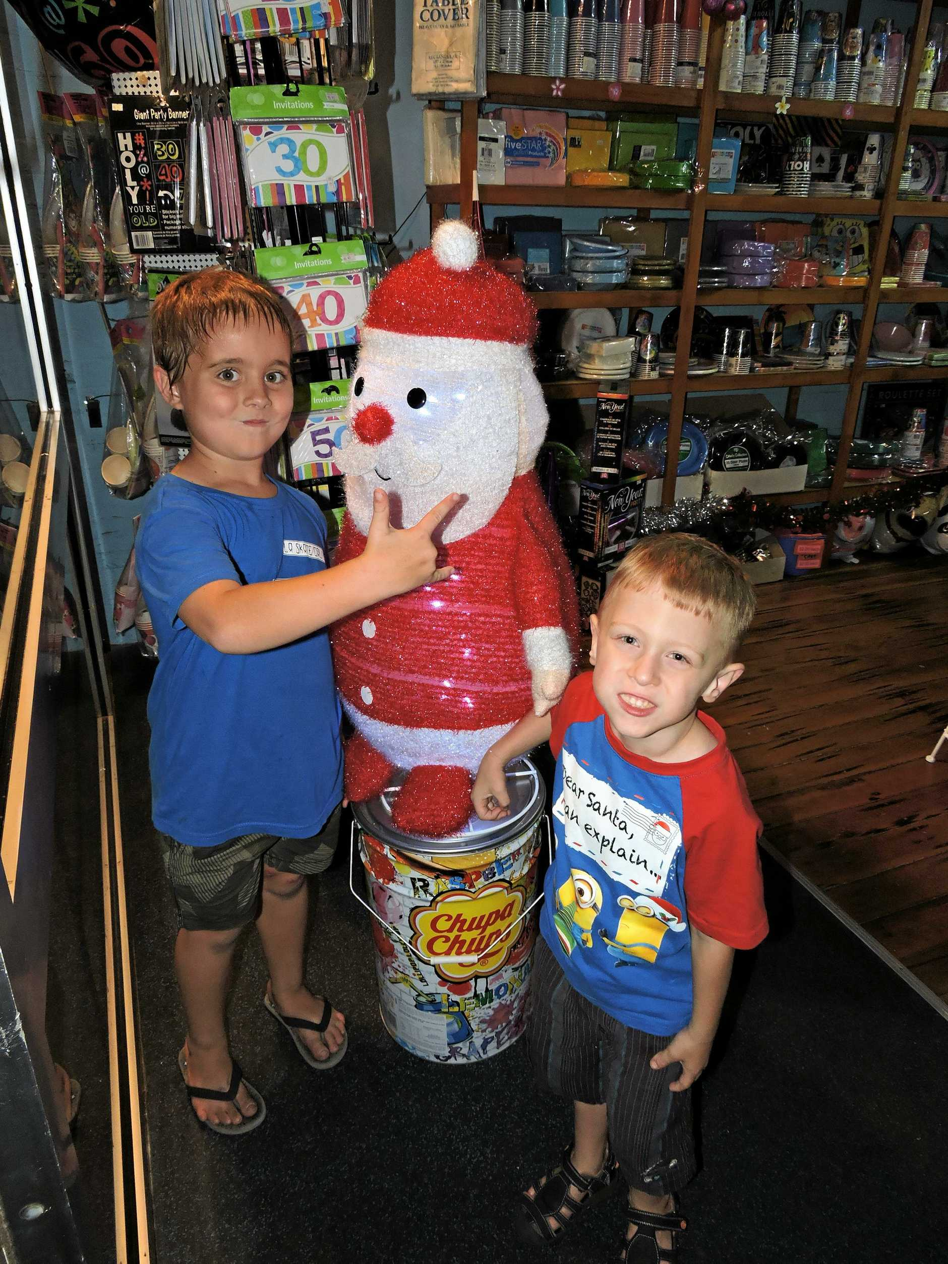 Checking out the decorations and the lollies in The Land of Sweets as is kept its doors open for the Mary Christmas CBD Street Party were Declan Bonnor, 6, and Reuben Bradford, 4 (right).