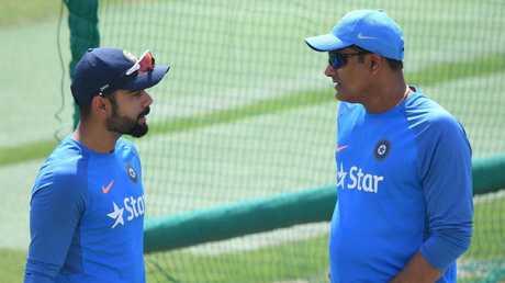 Virat Kohli with Anil Kumble.