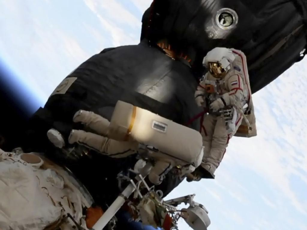 Russian cosmonauts Oleg Kononenko, right, and Sergei Prokopyev perform a space walk outside the Soyuz spacecraft attached to the International Space Station. Picture: NASA via AP