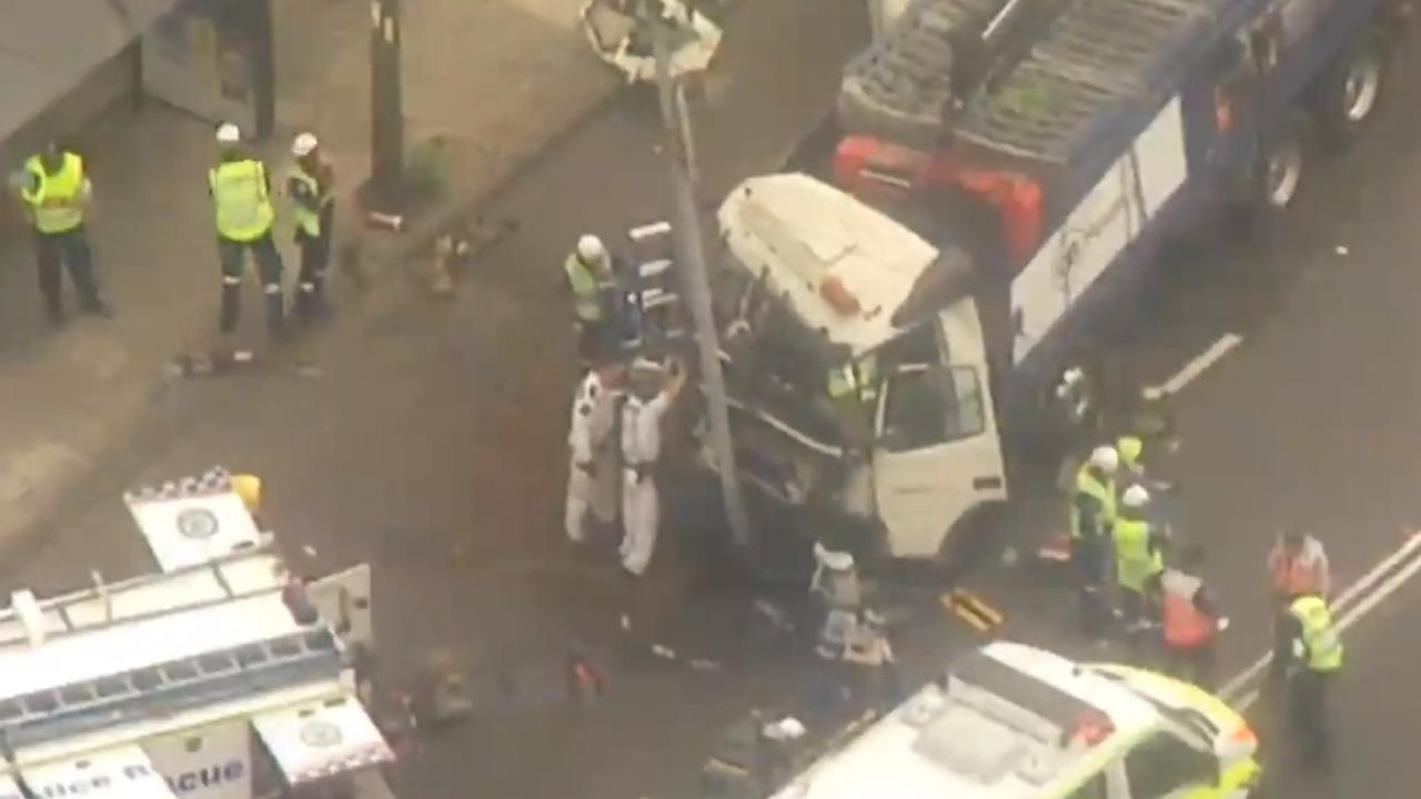 Several people injured, including pedestrians, following a truck and car crash on Botany Road between Bourke Street and Epsom Road in Sydney's Alexandria. Picture: Seven News