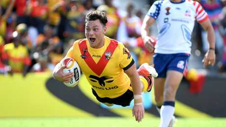 Lachlan Lam flies in for a try for Papua New Guinea during the Rugby League World Cup.