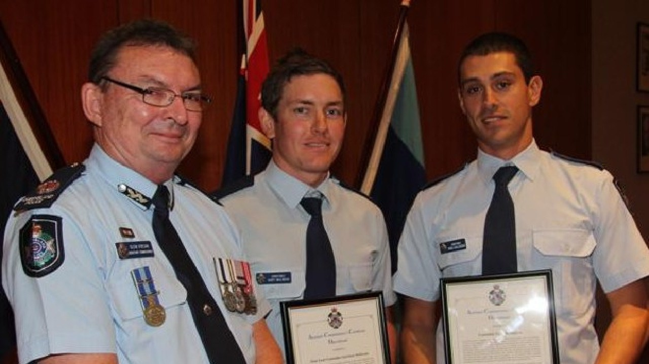 Garrison McIlwain (centre) was awarded an Assistant Commissioner's Certificate (Operational) for their professionalism, resourcefulness and dedication to duty in an extremely stressful situation in Innisfail on 8 March, 2013.