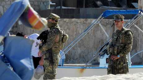 Mexican Marines patrol the beach ahead of the wedding. Picture: Nathan Edwards