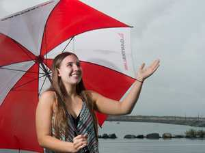 Danielle Hankinson, 18, enjoys the rain at the end of