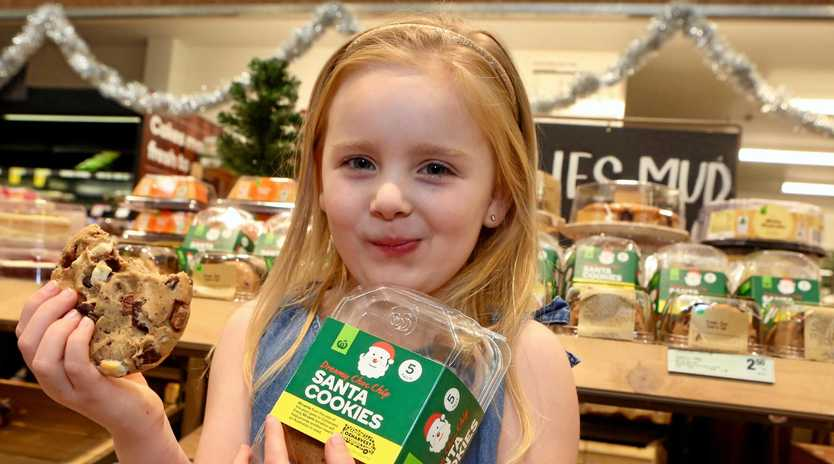 FESTIVE FUNDRAISE: Woolworths are raising money for Oz Harvest until Christmas Eve.