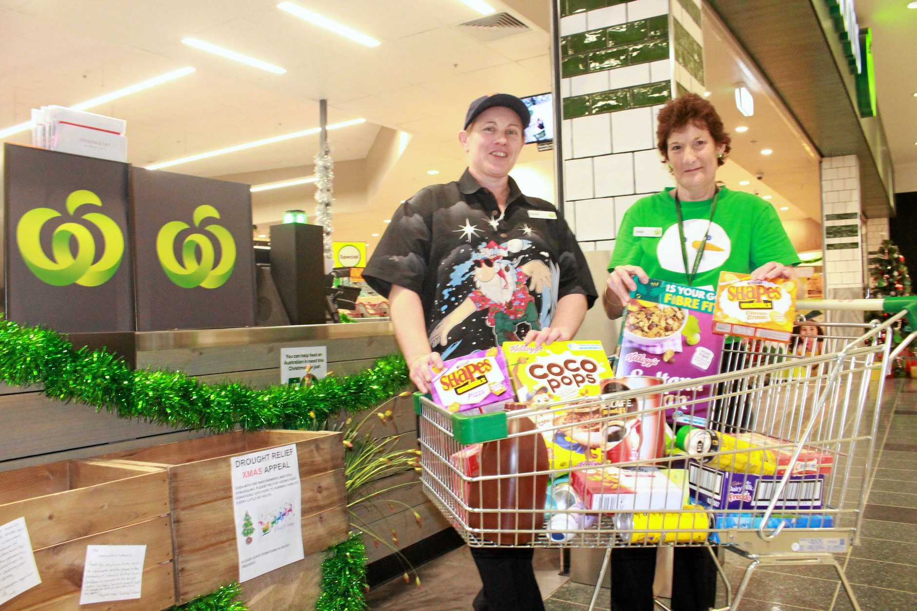 COME ALONG: Woolworths staff members Suzan O'Dea and Verlie Rhodes are asking Warwick residents to lend a helping hand this Christmas.