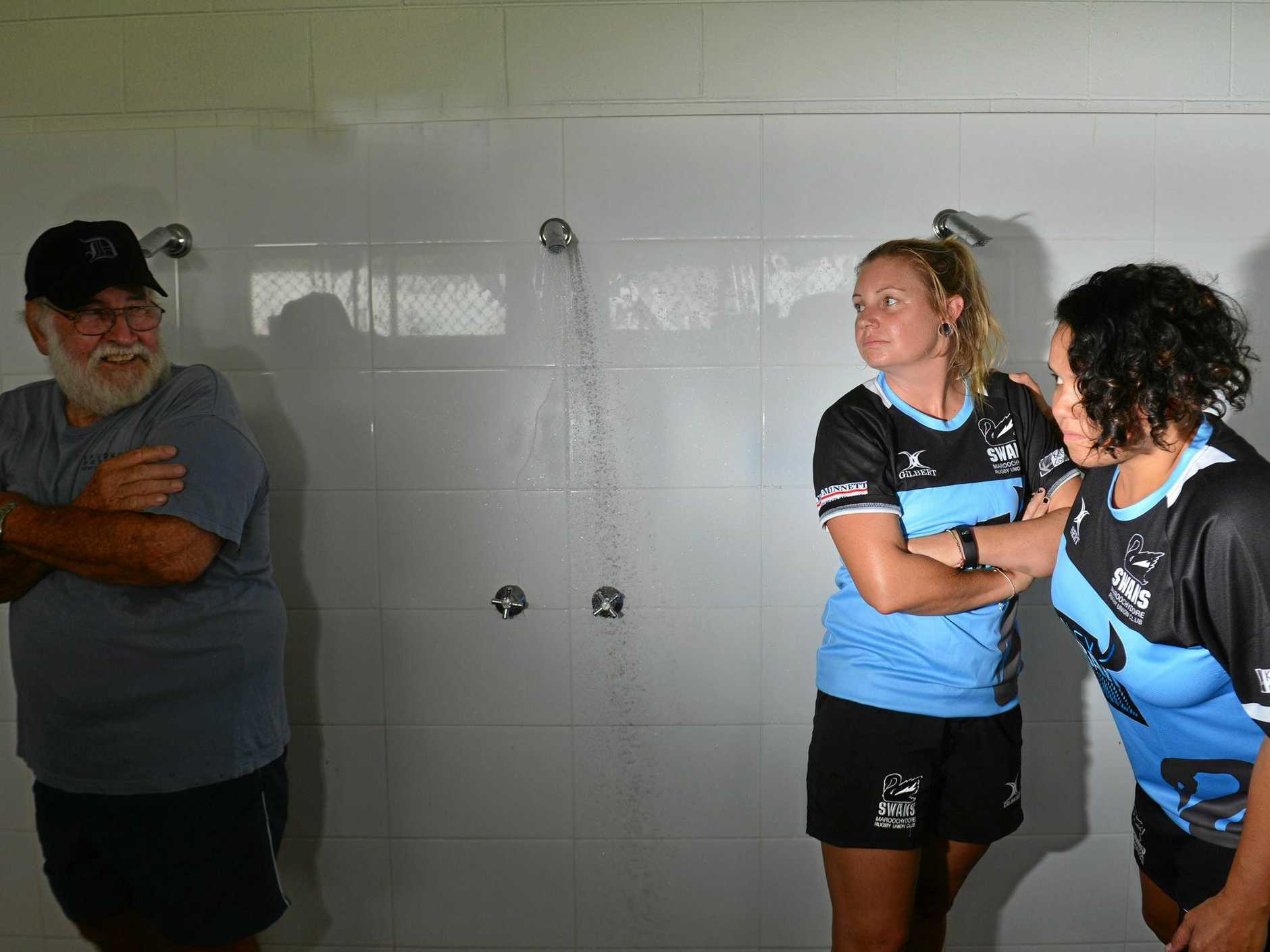 Maroochydore Rugby Union Club women's players Kara Reading and Chanelle Kawana share the club's only change rooms with groundskeeper Basil Harris.