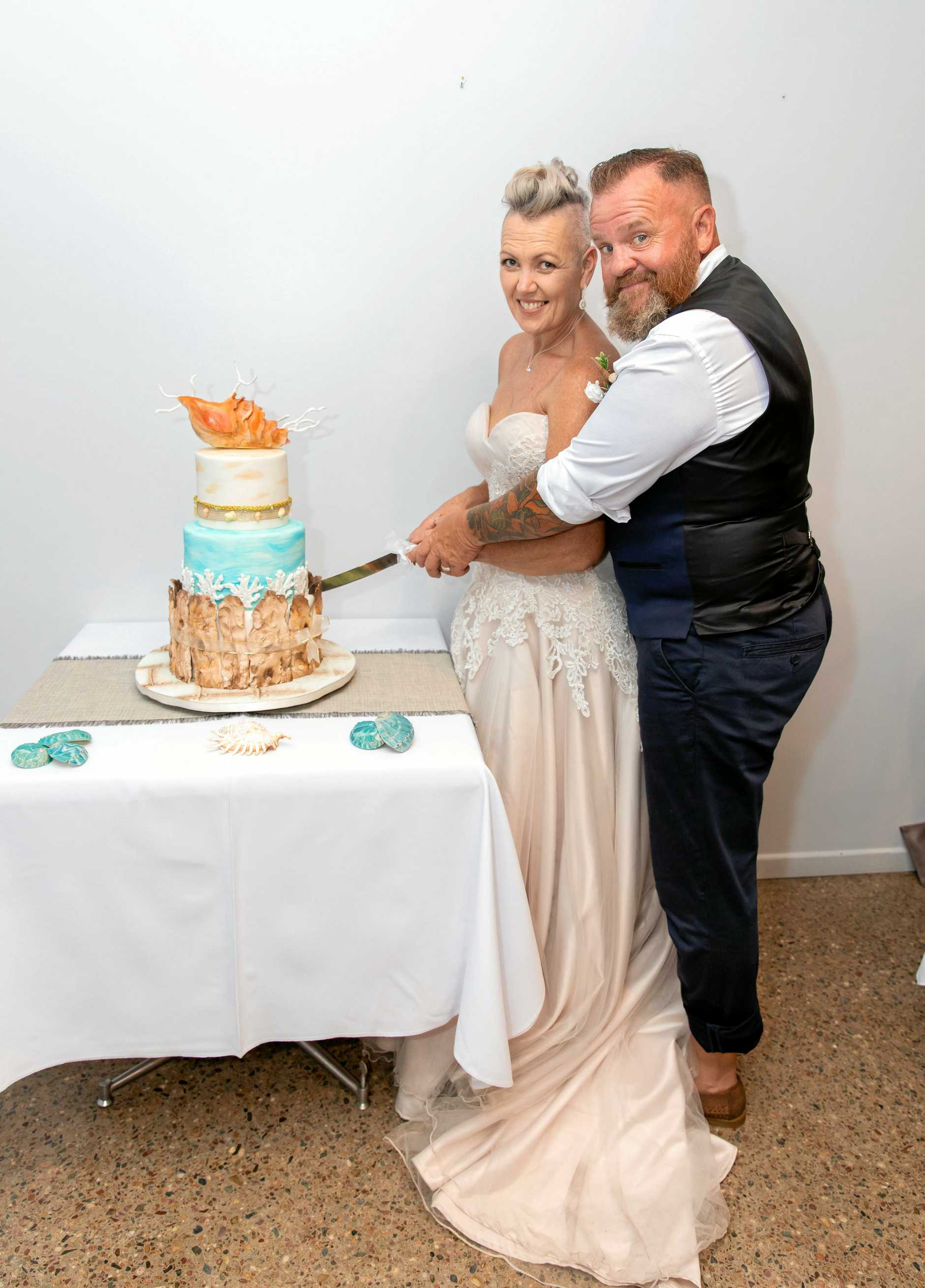 Sonya and her husband Craig Partridge with their wedding cake.