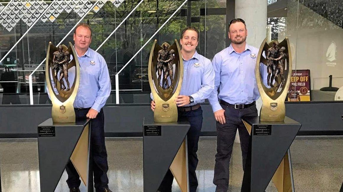 BRONCO VISIT: South Burnett coaches Scott Prendergast, Blake Mara and Carl Braithwaite with some of the Broncos premiership trophies.