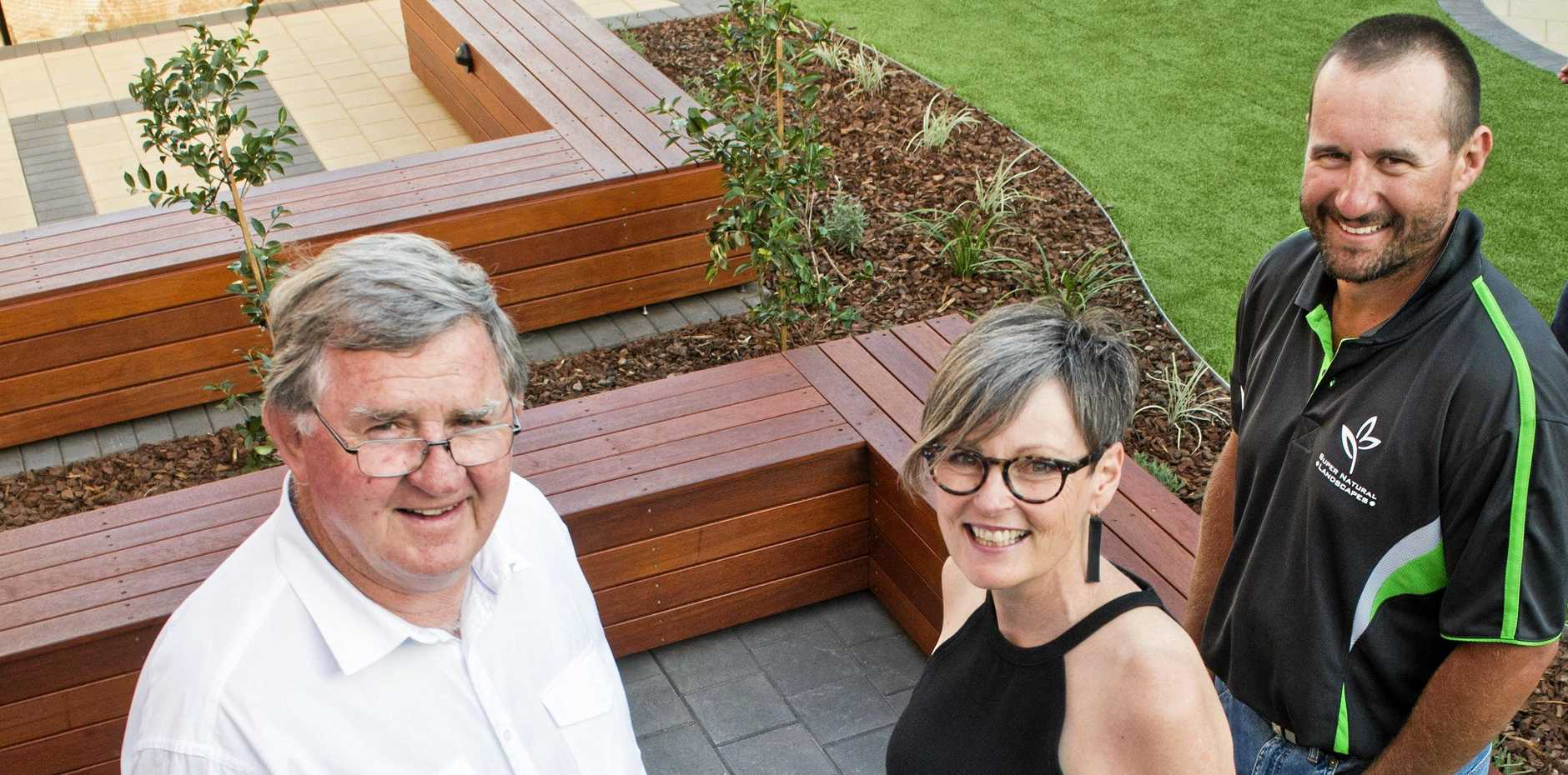 GREEN THUMBS: Instrumental in seeing the headspace Toowoomba sensory and wellbeing garden become a reality are (from left) Perry Dayas, Michelle Wiersma and Super Natural Landscapes' Barry Sweet.