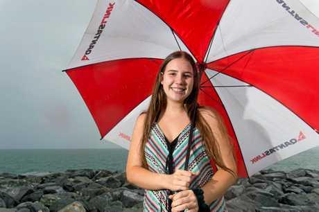 Danielle Hankinson, 18, enjoys the rain at the end of the breakwater on Thursday.