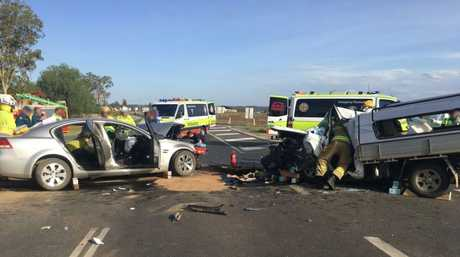 Emergency services at the scene of the crash on Gatton Helidon Rd.