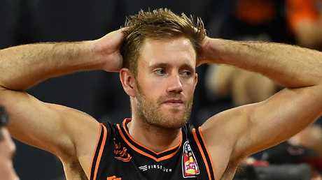 CAIRNS, AUSTRALIA — NOVEMBER 17: Mitch Young of the Taipans looks dejected after losing the round six NBL match between the Cairns Taipans and the Perth Wildcats at Cairns Convention Centre on November 17, 2018 in Cairns, Australia. (Photo by Ian Hitchcock/Getty Images)