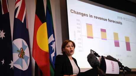 Queensland Treasurer Jackie Trad delivers the MYFER. Picture: AAP/Dan Peled