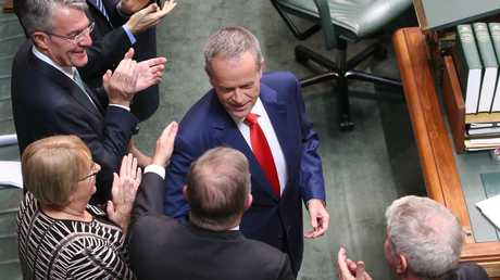 Anthony Albanese shakes hands with Opposition Leader Bill Shorten after delivering his Budget reply speech in Parliament. Picture Kym Smith