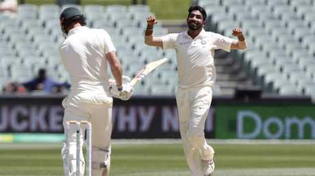 India's Jasprit Bumrah, right, celebrates after dismissing Australia's Shaun Marsh.